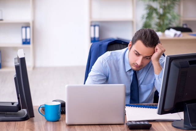 Male employee unhappy with excessive work