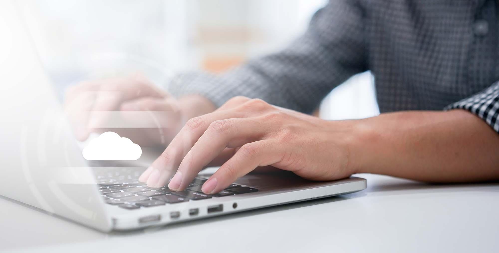 typing on laptop